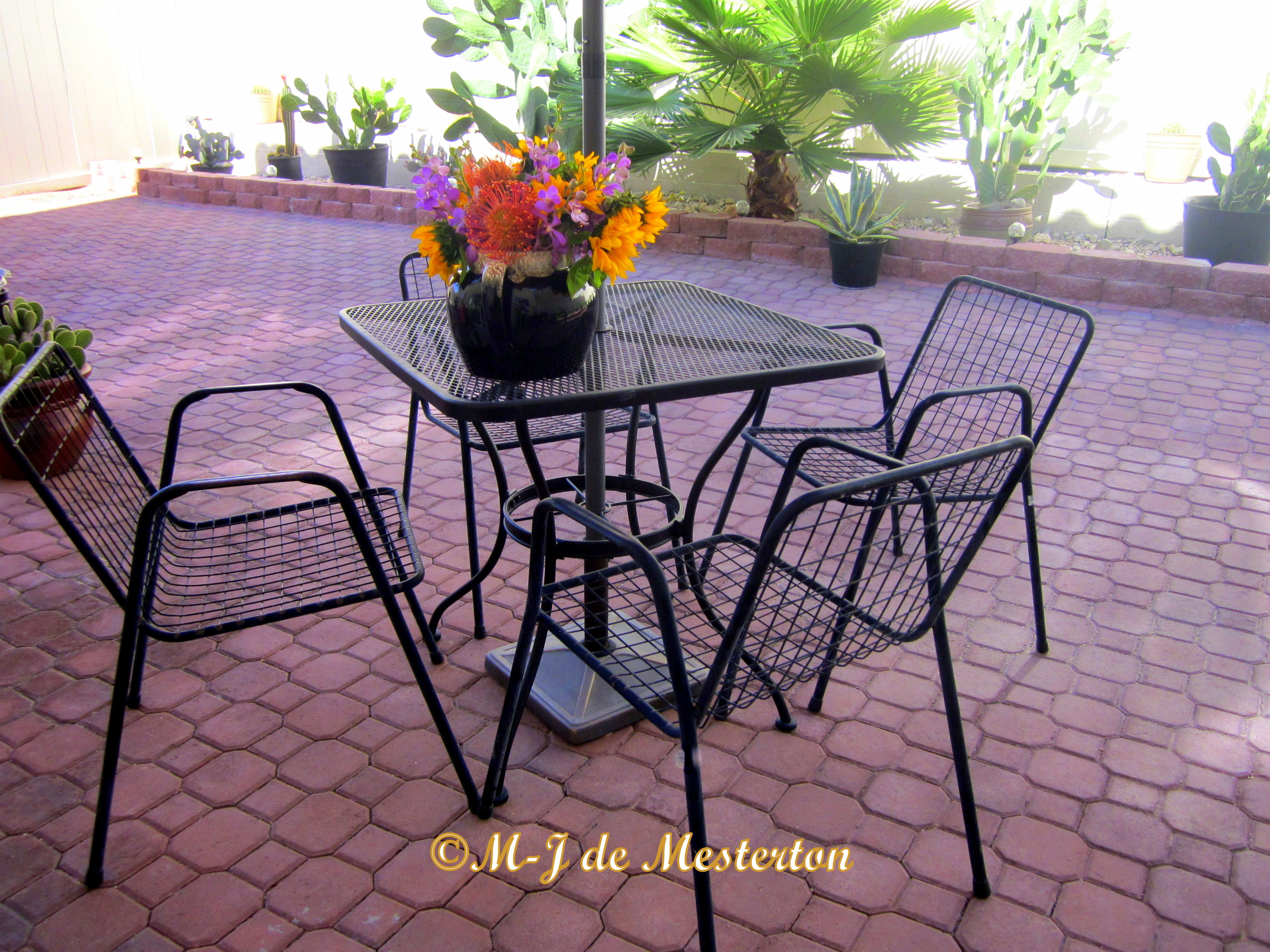 Garden furniture that stays put in the wind is made from lightweight metal with a wide-open mesh. So, instead of the wind blowing over your chairs, it passes right through them. ©M-J de Mesterton 2016